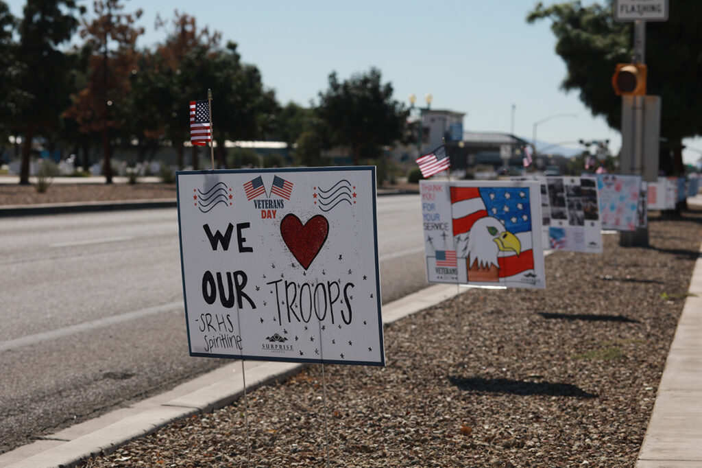 Hand made Veterans Day signs displayed along Bullard Ave.