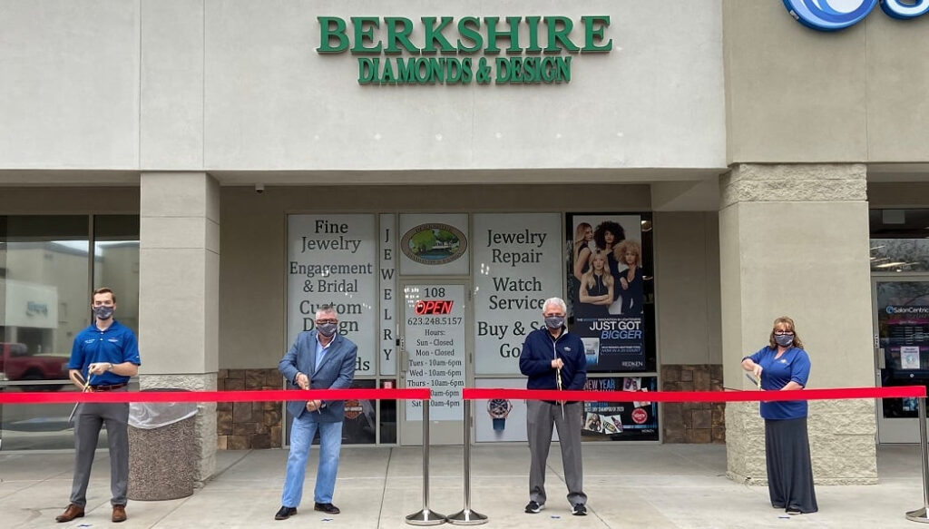 Mayor Hall and Councilmember Hastings cut red ribbons at Berkshire Diamonds & Design.