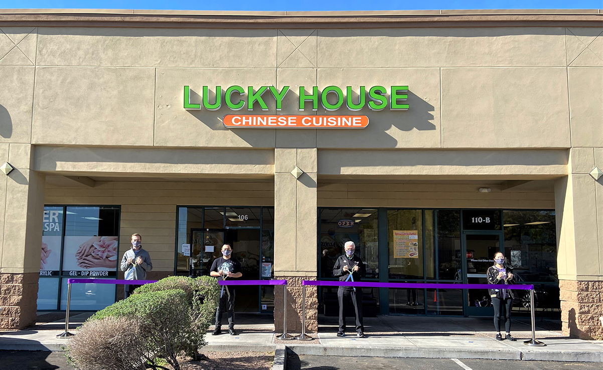 Mayor Hall and Councilmember Hastings perform the ribbon cutting in front of Lucky House Chinese Cuisine.