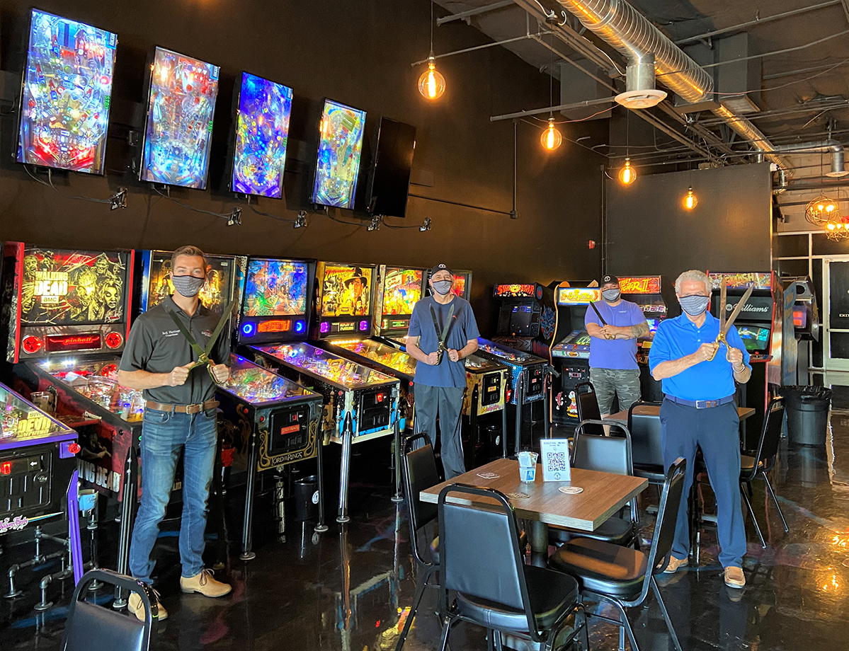 Mayor Hall, Councilmember Hastings, and owners of Player 1 Arcade inside the newly opened business.