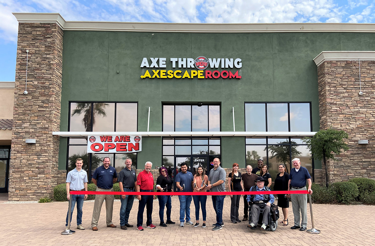 Surprise City Council and BADAZ Axes owners cut a red ribbon in front of the business.