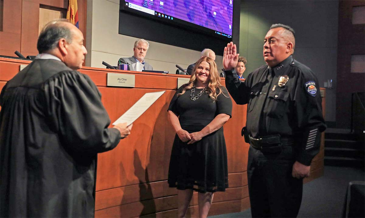 Chief Benny Piña take the oath of office, given by Judge Dominguez.
